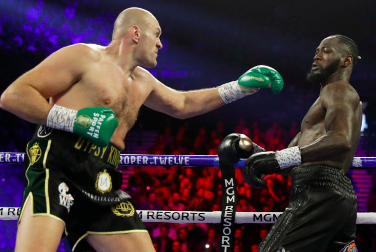 Tyson Fury jabs Deontay Wilder